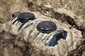 foto of wastewater  - A close up view of a newly installed septic tank system at a residential property for removal and purification of household grey wastewater and sewage - JPG