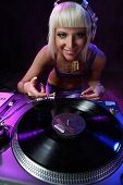 beautiful girl dj playing on vinyl player