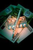 Banknotes With Pills Blister And Thermometer
