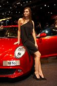 PARIS, FRANCE - OCTOBER 02:  female model posing near a car at Paris Motor Show 2008 on October 02, 2008