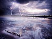 foto of lightning bolts  - Lightning Strikes a salt lake - JPG