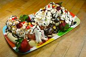 stock photo of banana split  - Enormous sundae with fresh fruit and lots of ice cream - JPG