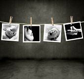Pictures of a newborn and mother in a darkroom