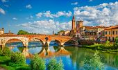 Panoramic view to Bridge Ponte Pietra in Verona on Adige river. Veneto region. Italy. Sunny summer d poster