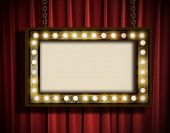 picture of marquee  - A grungy sign with marquee lights hanging by chains against a red velvet curtain - JPG
