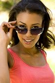 Exotic woman wearing her sunglasses