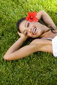 stock photo of black woman spa  - Beautiful exotic woman with a red hibiscus - JPG