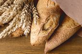 Tasty Crusty Baguettes On Wooden Background Tasty Homemade Bread Above Close Up poster
