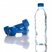 dumbbells and bottle of fresh water isolated on white