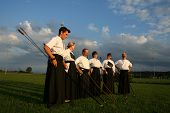 kyudo group posing at sunset