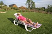 woman pensioner relaxing in her garden