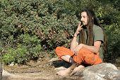 hippy preparing, rolling and smoking marijuana joint : photos series