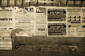 hasidic jews walking in front of propaganda panels, jerusalem, israel
