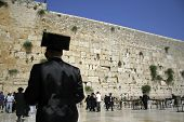 Hasidic jews at the wailing western wall, jerusalem, israel