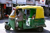 sikh driver waiting for passenger, new delhi, india