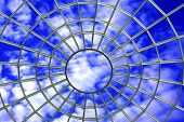 Roof top window web on blue cloudy sky background