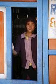 ANNAPURNA, NEPAL - MAR 19 : A young girl in her shop shed selling food and drinks to trekkers on March 19, 2008 in Annapurna, Nepal. Annapurna region is well known for its trekking activities.