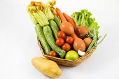 Different Vegetables In The Basket Isolated White Background / Vegetables In A Basket Isolated On Wh poster