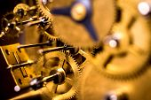 Gears Or Cogs Into A Mechanically Clockwork, Brassy Background poster