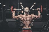 Handsome Strong Bodybuilder Athletic Men Pumping Up Muscles With Dumbbells poster