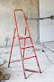 Ladder In Messy Renovated Room