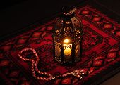 stock photo of namaz  - Arabic lantern on red carpet with wooden rosary - JPG