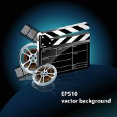 video film tape with cinema clapper and filmstrip on blue background