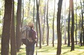 Relax Adventure And Lifestyle Hiking Travel Idea Concept. Young Man Traveler With Backpack Relaxing  poster