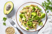 Vegan Pasta. Whole-grain Pasta Penne With Broccoli, Avocado, Green Beans, Peas And Pine Nuts. poster