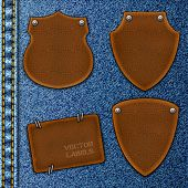 Leather labels on a denim background. Vector illustration Eps10