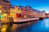 Copenhagen Nyhavn, New port of Copenhagen, at night in Denmark poster