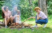 Friends Hang Out Near Bonfire Picnic. Company Youth Camping Forest Prepare Bonfire For Picnic. Add S poster