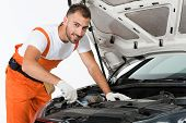 Handsome Auto Mechanic Auto Mechanic Repairing Car With Wrench On White poster