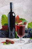 Bottle And Glass Of Red Mulled Wine Mockup For Your Logotype. Red Grapes, Spices Cinnamon, Anise, Cl poster