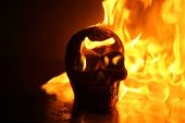 Halloween. Human Skull on fire. Hell fire and brimstone. Hot fire poster