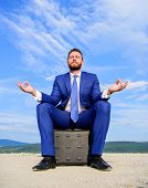 Businessman Formal Suit Sit On Briefcase And Meditating Outdoors. Entrepreneur Find Minute To Relax  poster