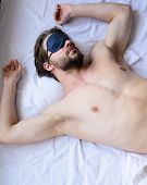 How Eye Mask Help Sleep Better. Man Sleepy Unshaven Bearded Face Sleep In Eye Mask. Guy Sexy Macho L poster