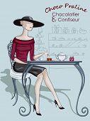 beautiful stylish woman sitting at a cafe
