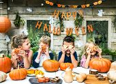 Playful kids enjoying a Halloween party poster