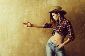 Nonverbal Communication, Gunfighter. Pretty Girl Or Sexy Woman With Blond, Long Hair In Stylish Cowb poster