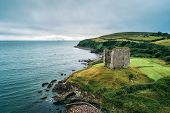 Aerial View Of The Minard Castle Situated On The Rocky Beach Of The Dingle Peninsula With Views Acro poster