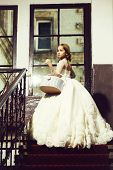 Small Girl Kid With Long Blonde Hair And Pretty Face In Prom Princess White Dress With Basket Standi poster