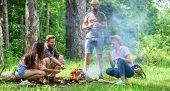 Roasting Marshmallows Popular Group Activity Around Bonfire. Company Friends Prepare Roasted Marshma poster