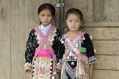 stock photo of hmong  - Laos Hmong girl in traditional clothes in the surroundings of Luang Prabang - JPG