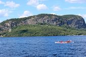 stock photo of moosehead  - Two kayakers enjoying Moosehead Lake in Maine and the view of Mount Kineo in the distance - JPG