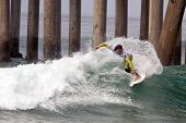 HUNTINGTON BEACH, CA - AUGUST 2: Tim Reyes competes in the Nike US Open of Surfing in Huntington Beach, CA on August 2, 2012