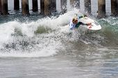 HUNTINGTON BEACH, CA - AUGUST 2: Tanner Gudauskas competes in the Nike US Open of Surfing in Hunting