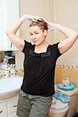 Portrait Of Pretty Caucasian Beautiful Woman Dyeing Hairs At Domestic Bathroom poster