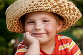 Boy In A Straw Hat