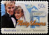 AUSTRALIA - CIRCA 1985: A stamp printed in Australia shows frame from the movie Neighbours